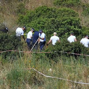 Bicester Advertiser: Police investigating the disappearance of Madeleine McCann in Portugal search a patch of scrubland
