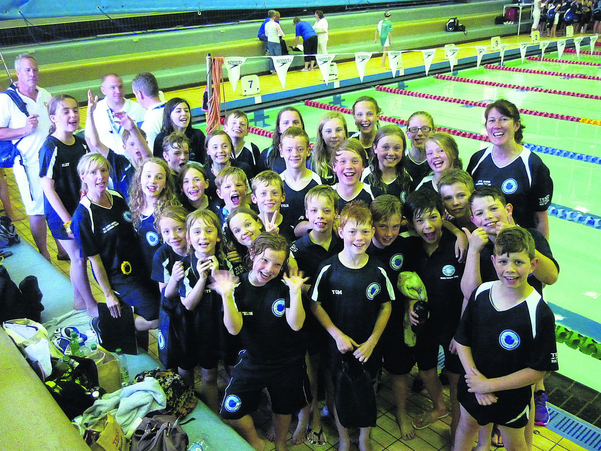 Bicester Blue Fins team celebrate finishing second in the Milton Keynes & District League opener