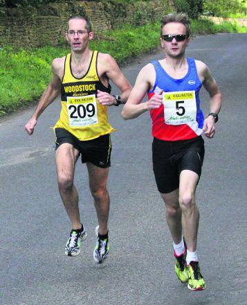 Oxford City's Darrell Bellinger (right) and Woodstock Harriers' James Bolton battle it out in the early stages at Bletchingdon Picture: Barry Cornelius