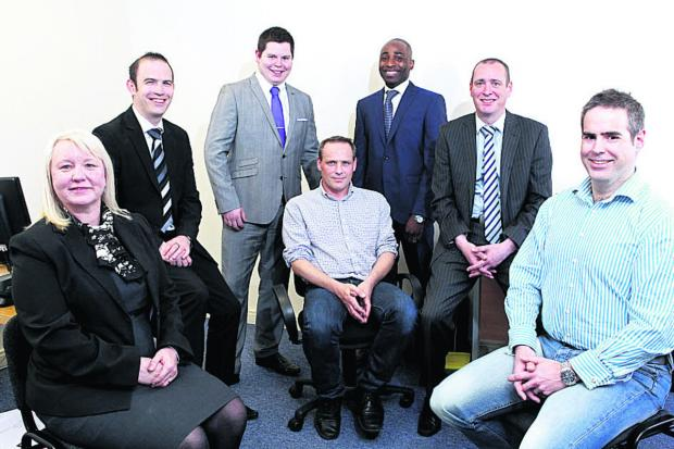 Back, from left, communications specialists Leigh Punter, Adam Millington, Simon Ezimokhai and Matthew Hutton. Front: Gill Moss, Adam Crisp and Chris Harding, of VOIP