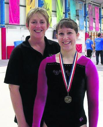 Carterton coach Debra Courtenay-Crane with gold medal winner Kate Dela