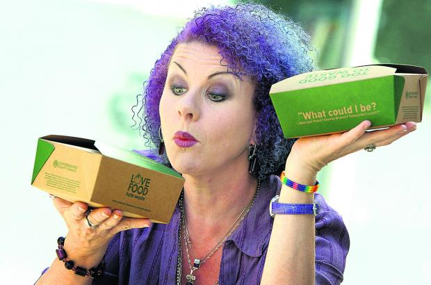 Mazz Image, creative consultant at The Big Bang restaurant, with some of the food boxes. Picture: OX67864 Damian Fantato