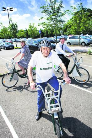 Oxfordshire County Council cabinet member for transport David Nimmo Smith, front, with Angela Lee from the John Radcliffe Hospital and James Gagg, from Oxford Brookes University