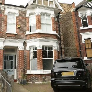 Bicester Advertiser: The front of former footballer Ian Wright's house in London, where his wife and children were burgled at knifepoint.