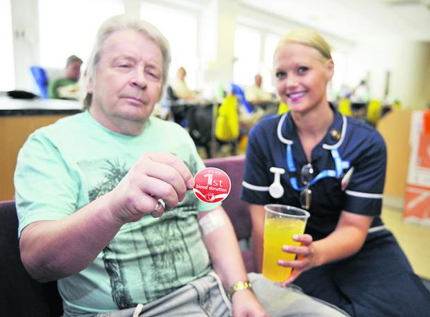 Bicester Advertiser: First-time blood donor Bob Buckley, 60 with donor carer Charlotte Coomber