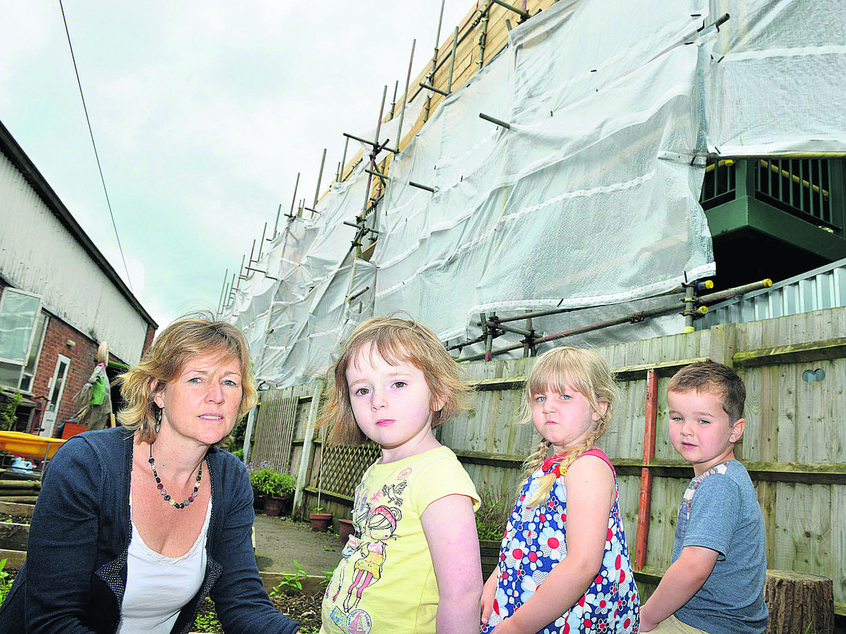 Andrea Leonard, from Childfirst Day Nursery in Bicester, with children, from left, Tessa Hart, three, Lorelai Hubbard, four, and Ollie Wickens, three, next to the bridge. Picture: OX67895 Simon Williams