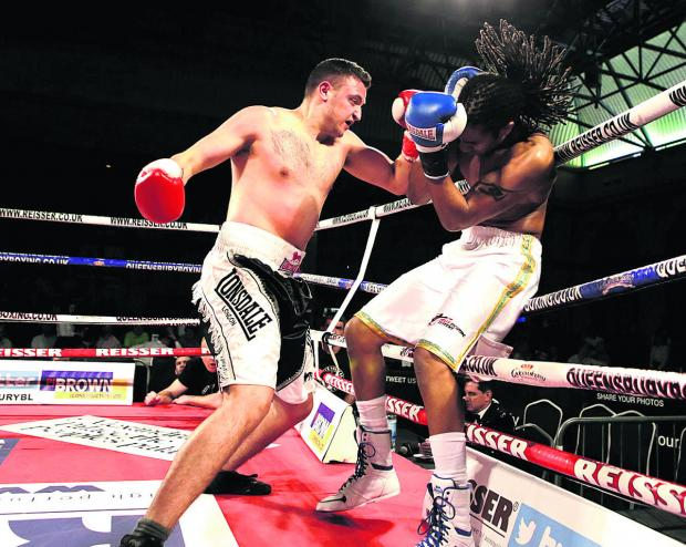 Terry Russell (left), seen on the attack during his defeat against Dominic Felix in his last fight, will bid to get back to winning ways against Freddie Yemofio