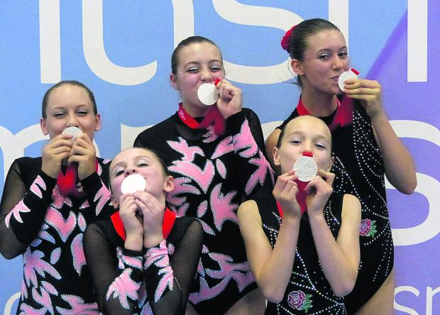 Bicester Advertiser: Oxford gymnasts (from left): Aysha Hutter, Charlotte Billington, Elspeth Jackson, Lucy Kavanagh and Ashley De La Haye celebrate