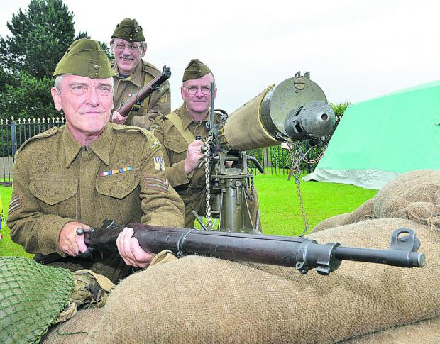 Bicester Advertiser: Bicester Home Guard Living History Group on guard at Bicester Carnival, from left, Steve Harris, Pete Chivers and Andy Hunter