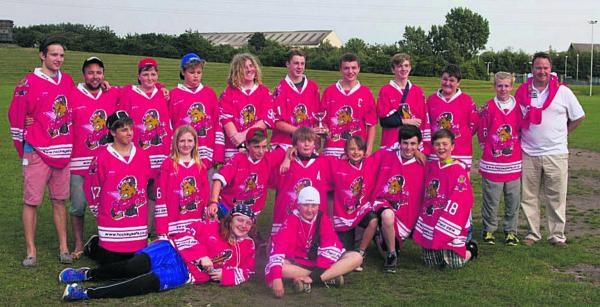 Oxford Junior Stars Under 14 team in their specially-made jerseys, which helped them raise more than £400 for  charity at a competition in Sheffield, where they finished runners-up