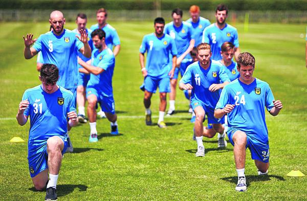 Oxford United's players began their preparations for the new  season this week (above), but as it stands Johnny Mullins (left) is one of only 11 fit senior players in the squad  Picture: Cliff Hide Order no: OX68316