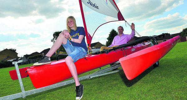Eleanor Ackroyd, 15, and estate agent Colin Barton with their Hobie Island Tandem sailing kayak