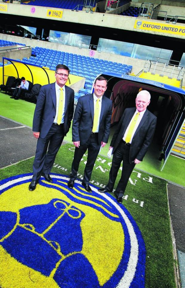 Bicester Advertiser: Darryl Eales (left), Mark Ashton and Ian Lenagan walk out of the Kassam Stadium tunnel after yesterday's press conference