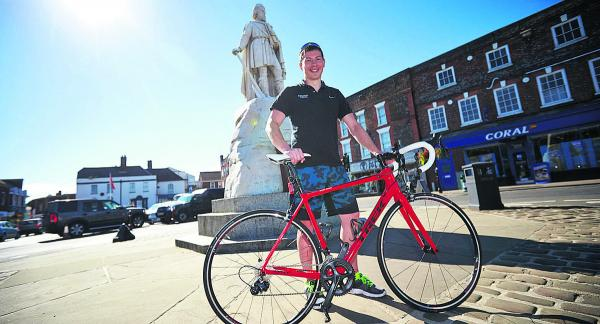 Gareth Hudson, who works at Ridgeway Cycles, in Wantage Market Square with a £3,000 carbon fibre Trek road bike. He is looking forward to the Tour of Britain