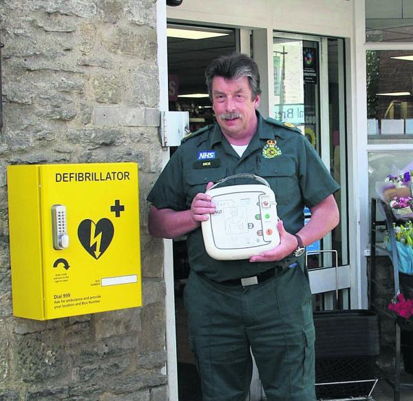 Bicester Advertiser: Dick Tracey from South Central Ambulance Service with a defibrillator installed in Eynsham, West Oxfordshire.  Picture: Steve Wheeler