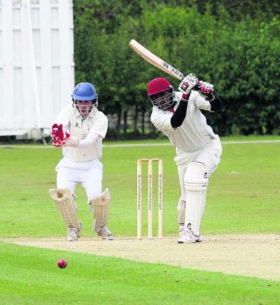 Twyford's Tanveer Hussain off drives during their game at Oxford Downs which was abandoned due to heavy rain