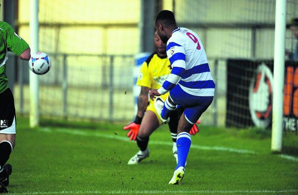 Oxford City's Adi Yussuf curls in a shot just off target last night
