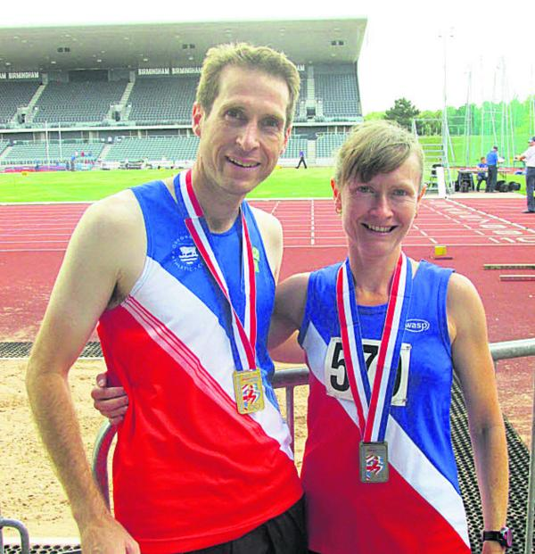 Les Newell and Sarah Davies with their medals
