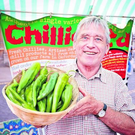 Ian Paxton, who farms chillis in Church Hanborough, holding a bowl of Anaheim chillis