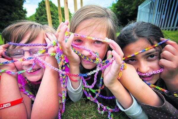 Top from left, Annabel Lally, Megan Davies and Jasmine Crowford with their 46-metre loom band