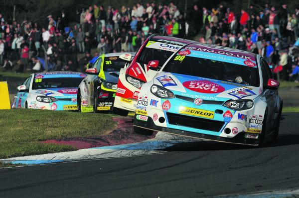Jason Plato cuts every corner possible to stay in front of the chasing pack at Knockhill   Pictures: Lee Foxon