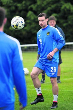 Will Hoskins is put through his paces in training yesterday
