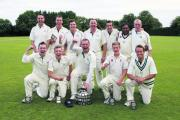 Marsh Gibbon's players celebrate winning the Telegraph Cup after beating Wantage by 33 runs in the final at Chipping Norton on Sunday