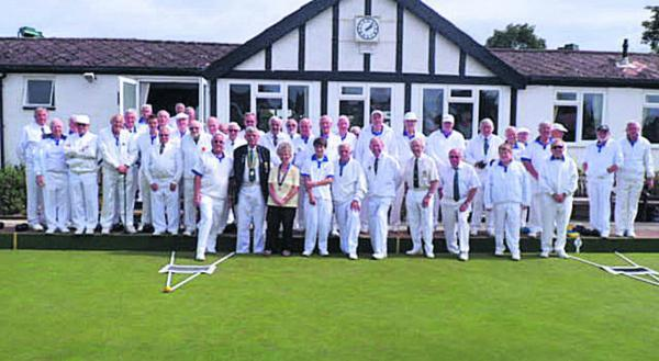 Thame's bowlers pose with their visitors from the Home Counties as part of the special match