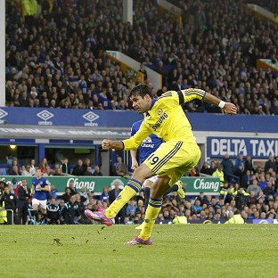 Diego Costa, right, scores the final goal of a 6-3 victory for Chelsea against Everton