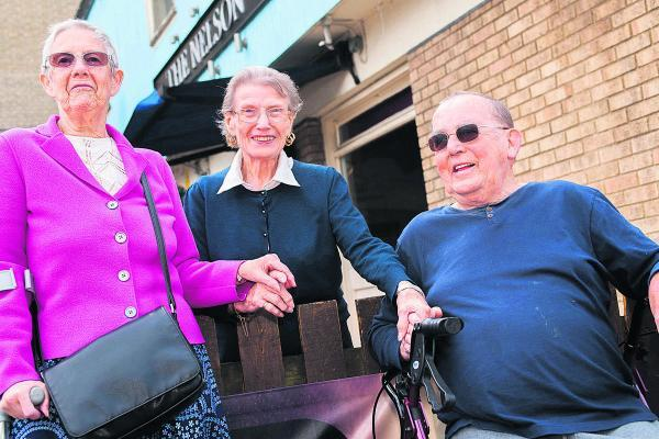 Former bar staff at The Nelson, David Lock and Freda Moffatt, left, with former landlady Ivy Morley at the now closed Cowley pub