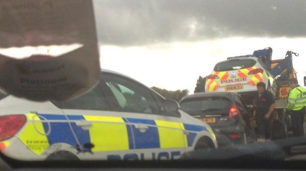 Police car ends up in ditch after collision in East Hanney. Picture by Tom Sutherland.