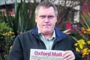 Andy Beal with a copy of the Oxford Mail from December 10