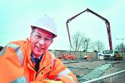 Rob Brighouse, managing director of Chiltern Railways, standing by the foundations of the new Bicester Town railway station
