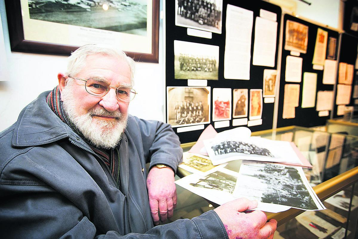 Sidney Smith's son Paul looks at items in the exhibition at Witney Museum                        Picture: OX71776 Damian Halliwell