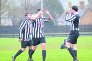 Steeple Aston's Luc Thornton (centre) takes the plaudits after scoring in their 6-0 win at Charlbury in the fourth round of the OFA John Fathers Junior Shield on Saturday Picture: Denis Kennedy