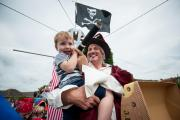 Eye, eye captain: Gary Summerfield and his son, George, two, aboard their pirate-themed float