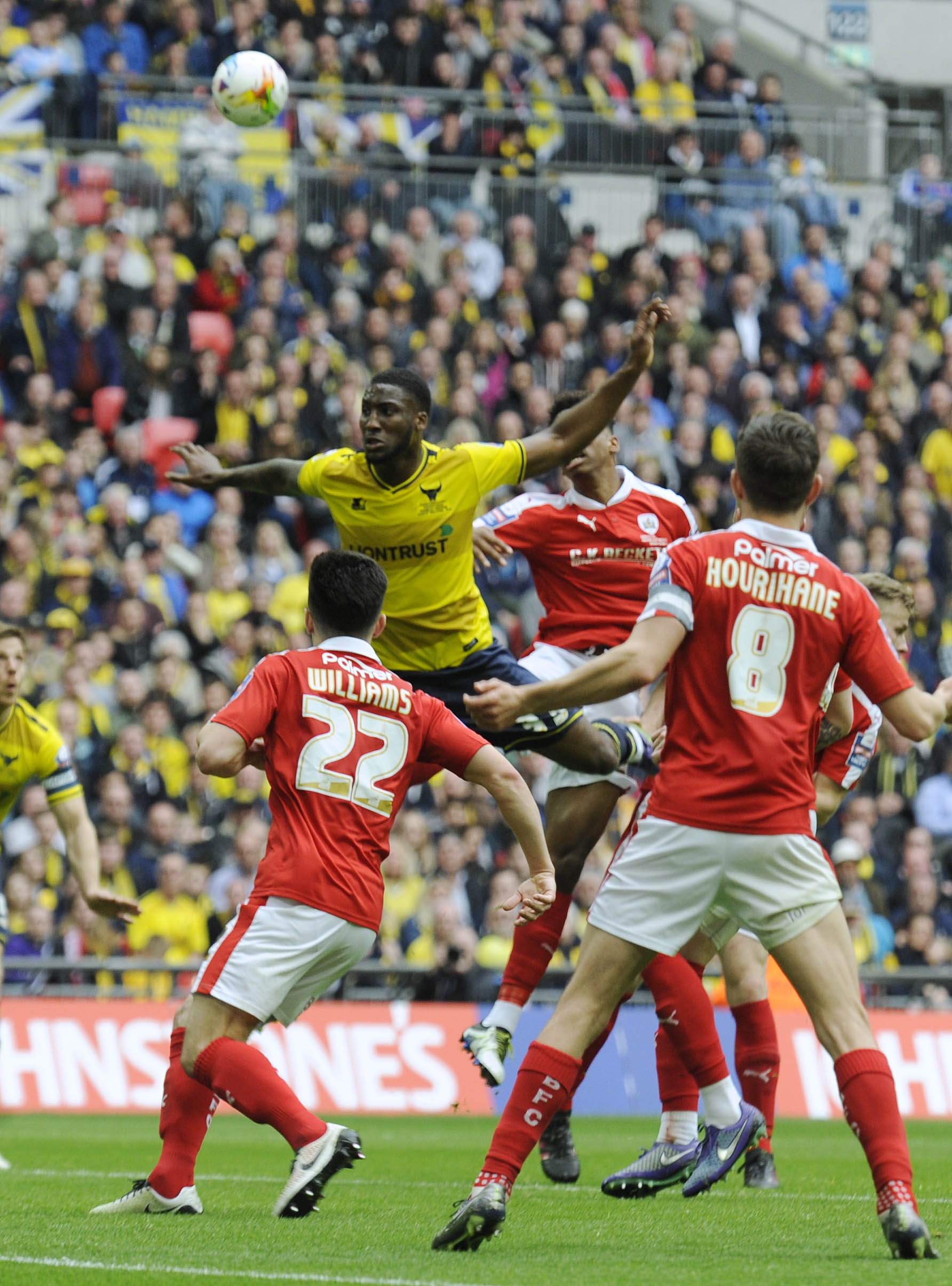 Chey Dunkley climbs above three Barnsley players during Oxford United's Johnstone's Paint Trophy final defeat Picture: David Fleming