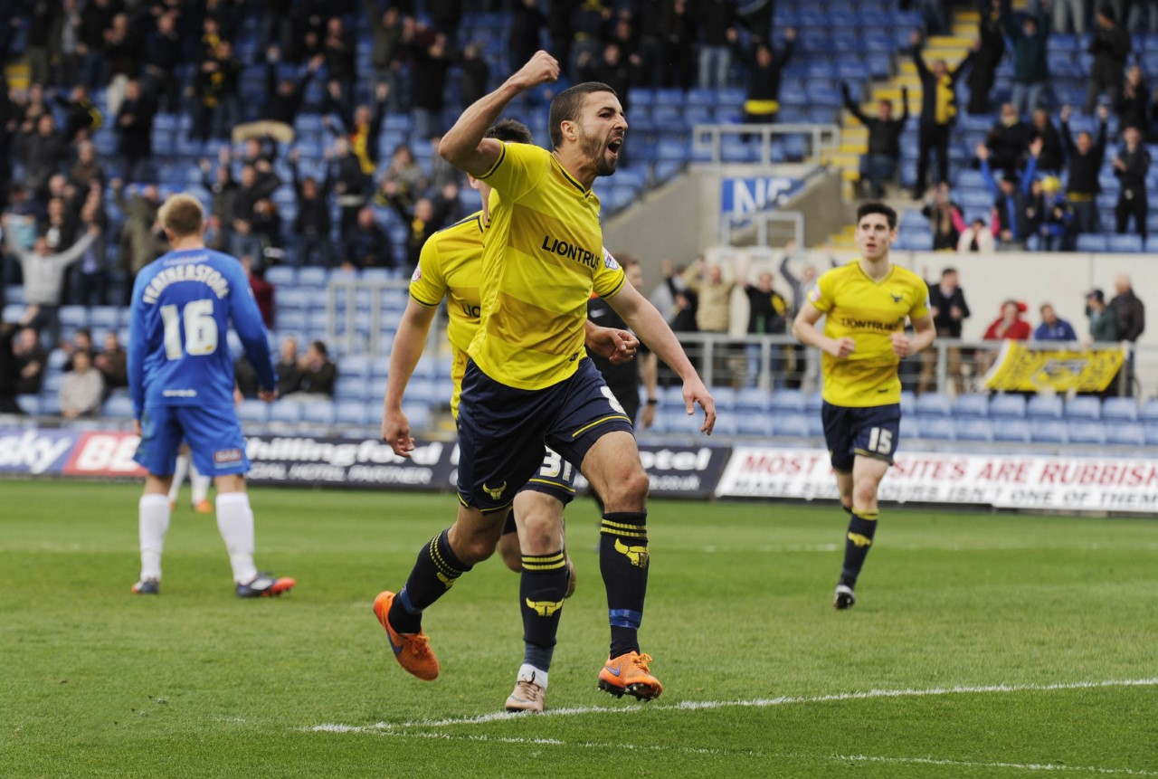 Liam Sercombe punches the air after wrapping up Oxford United's win with a late goal  Picture: David Fleming
