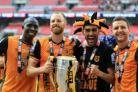 Mo Diame, left, and his Hull team-mates celebrate their return to the Premier League