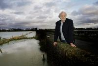 Bicester Advertiser: Farmer John Hook with flooded fields at Cote, near Bampton