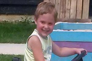 Woman charged over death of three-year-old boy attacked by dog