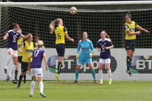 Oxford United's Riva Casley heads clear under pressure Picture: Steve Wheeler