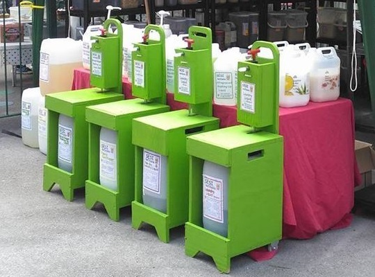 The green SESI detergent refill stations