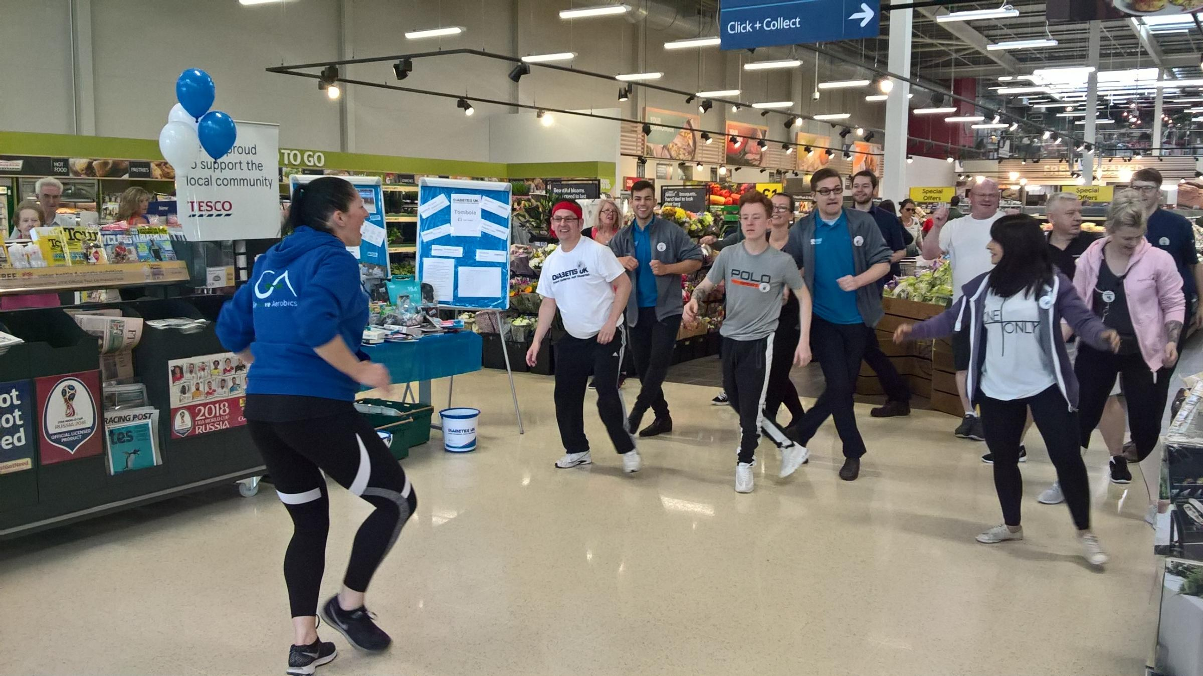 Staff and customers got stuck into a Tesco exercise class for Diabetes UK