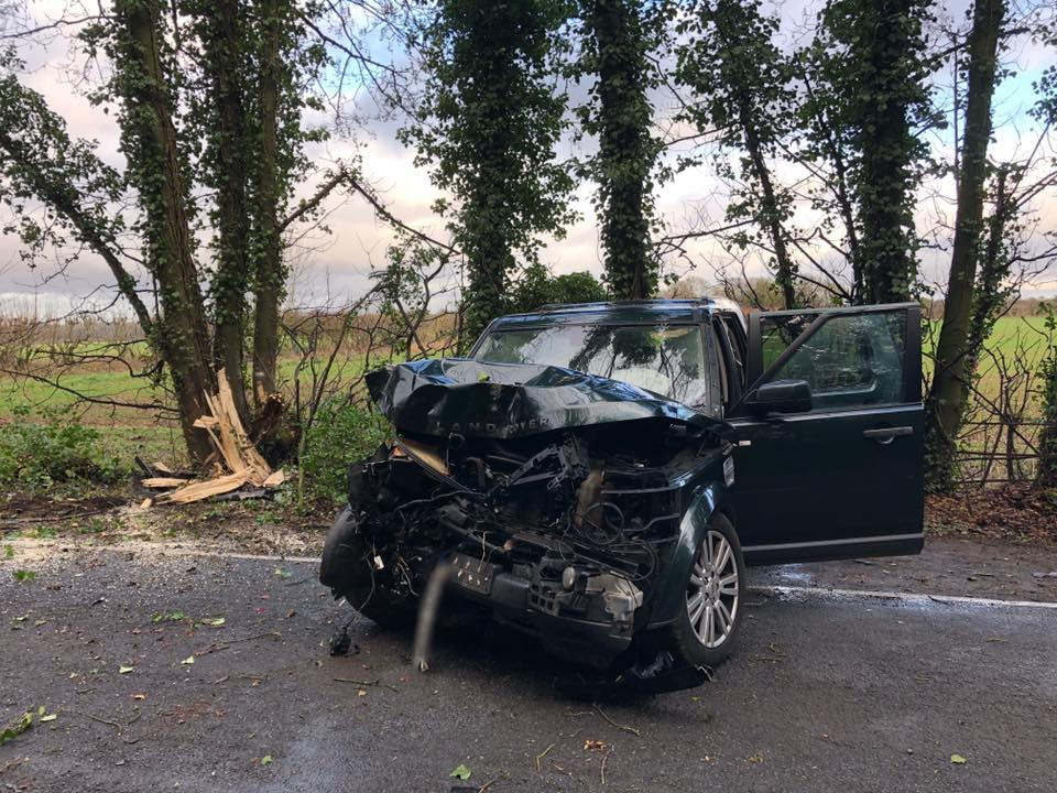 Road closed after car crashes into tree