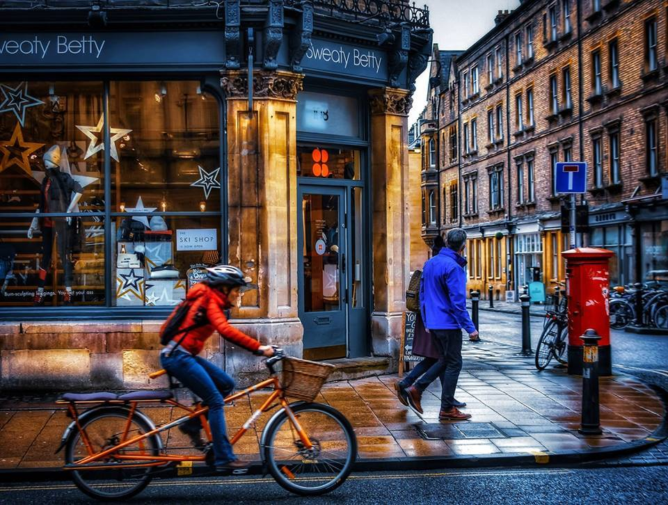 Cyclist rides through Oxford by Io Nutz