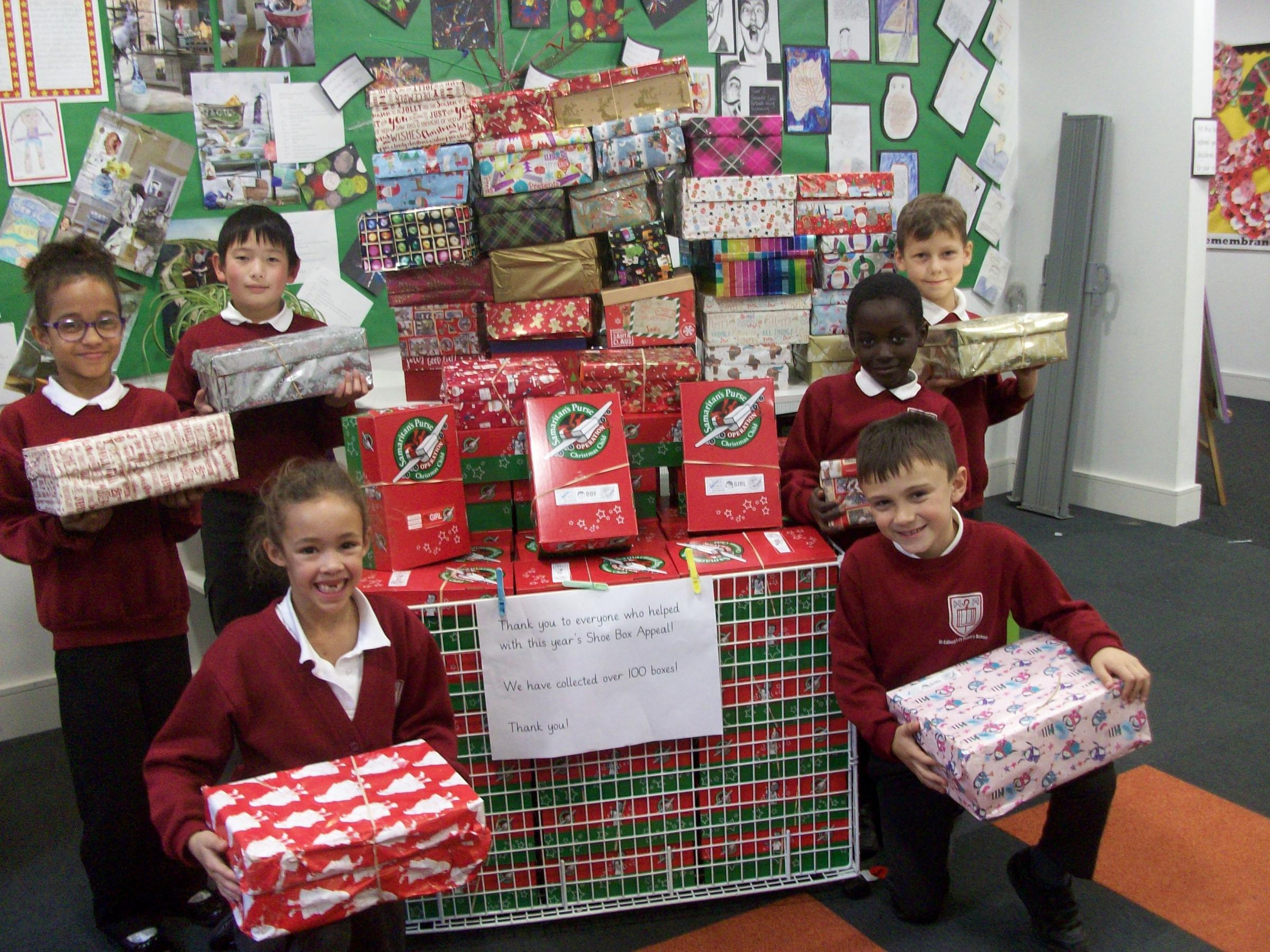 St Edburg's School pupils with their packed Christmas shoe boxes