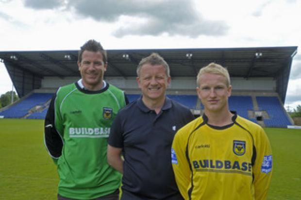 Bicester Advertiser: New signings Ryan Clarke (left) and Marcus Kelly with manager Chris Wilder