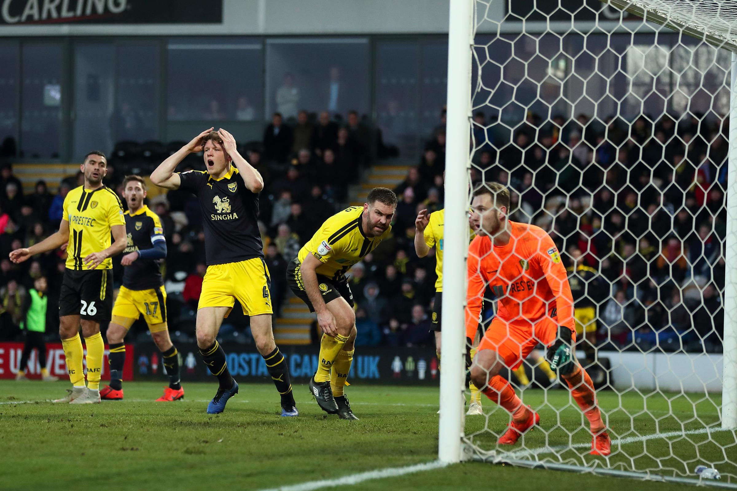 On a day of frustration for Oxford United, defender Rob Dickie cannot believe it as another chance goes begging against ten-man Burton Albion Picture: James Williamson