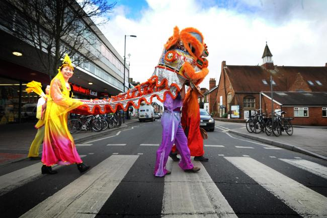 Oxfordshire Chinese Community & Advice Centre with a traditional dragon puppet. Picture by Jon Lewis